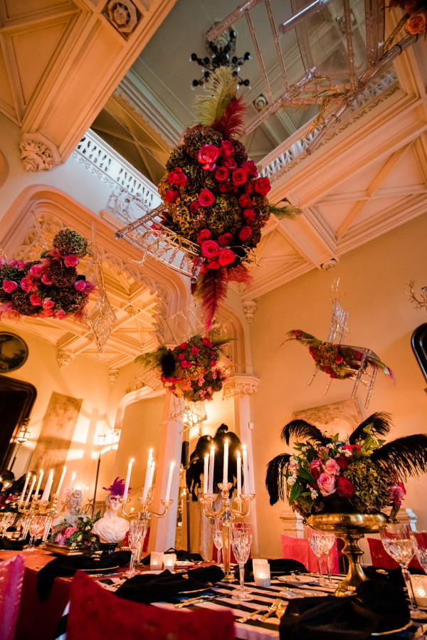 Wedding floral arrangement and candles inside Chateau Challain