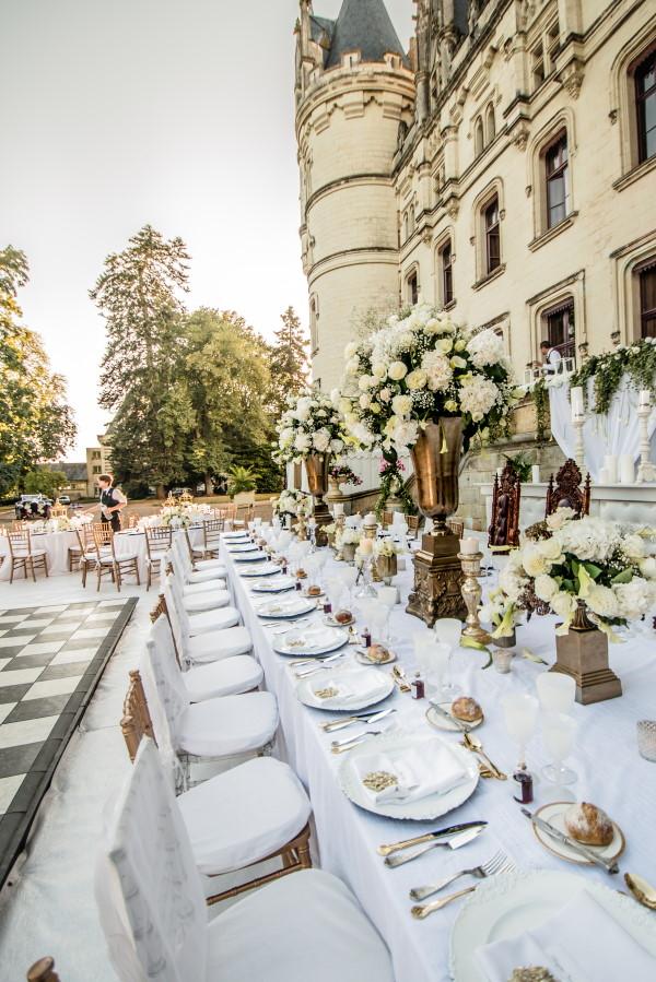 White wedding table setting outside Chateau Challain