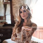 Bride blowing kiss surrounded by bubbles inside Chateau Challain