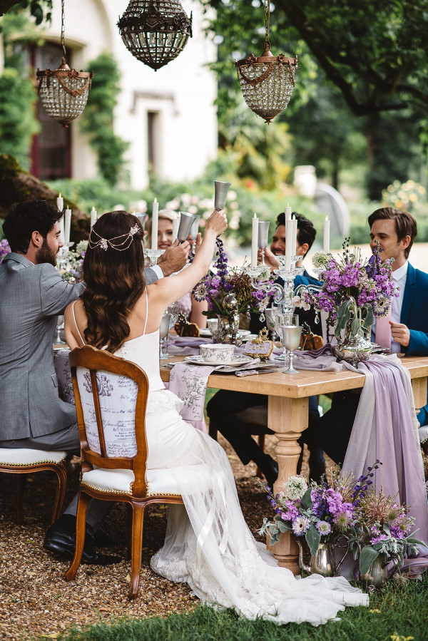 Bride and Groom at purple themed bridal table at Chateau Challain