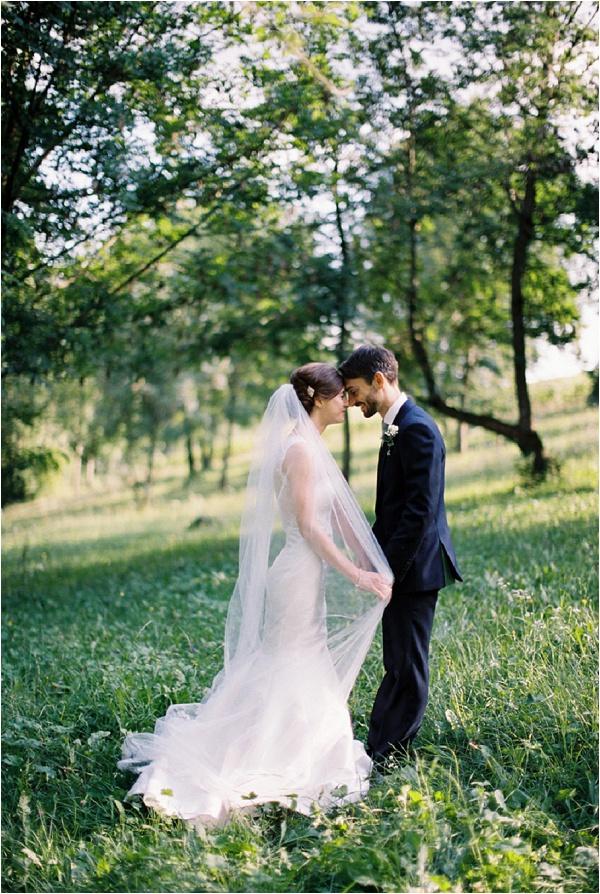 bride & groom with veil in gardens