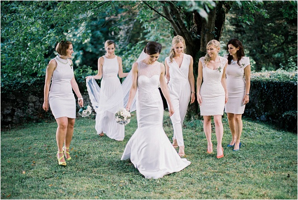 bride in gardens with bridesmaids