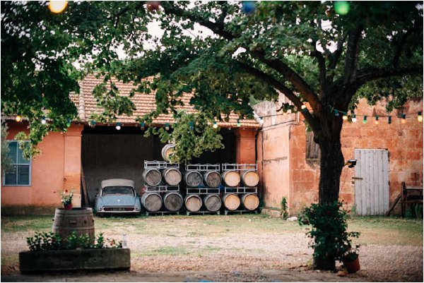 vintage French car and wine barrels