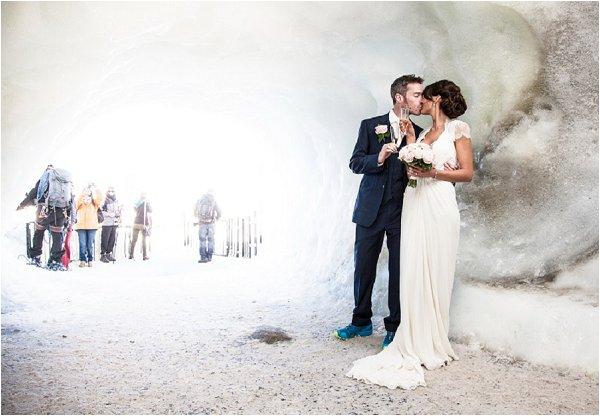 bride & groom under ice cave
