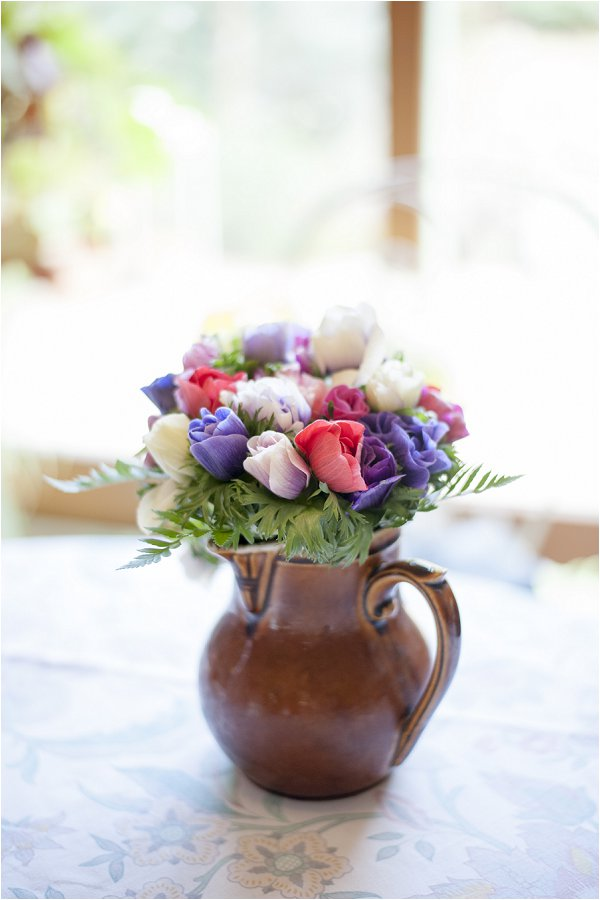 rustic jug filled with pretty flowers