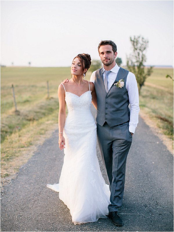 Bride and groom taking a stroll in the evening sunshine