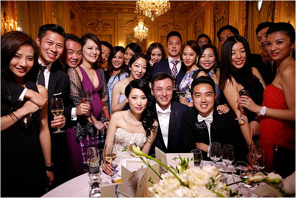 Bride and groom together with guests from all over the world