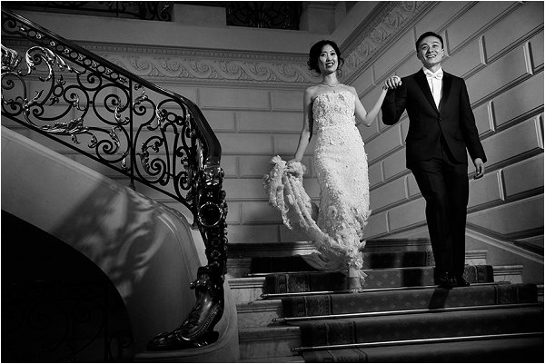 Bride wearing Lazaro gown and groom wearing Dior
