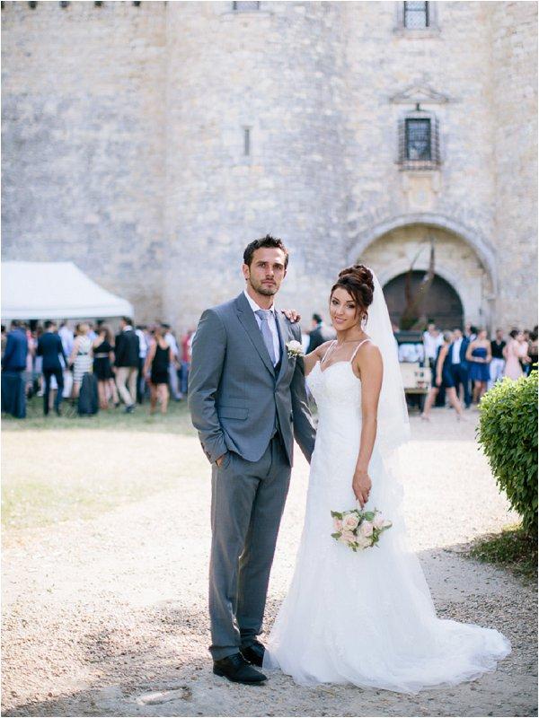 Gorgeous bride and groom outside Chateau de Mauriac