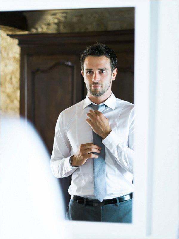 Handsome groom in grey wedding suit