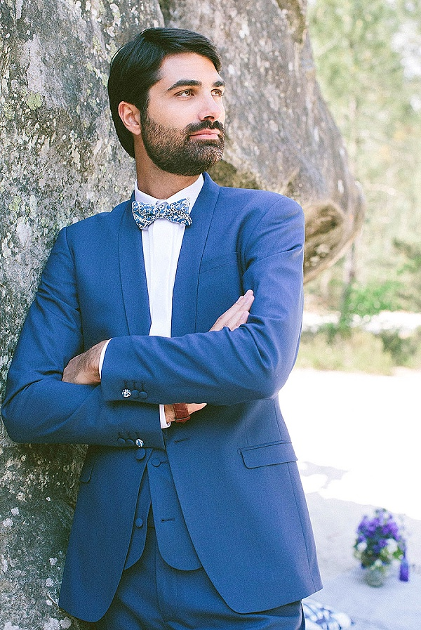 Navy blue suit with bow tie