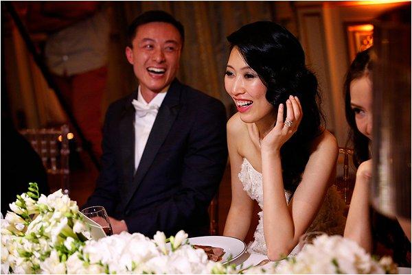 Smiling newlyweds enjoying their wedding breakfast
