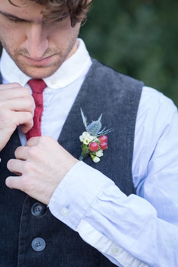 Winter berry wedding boutonniere
