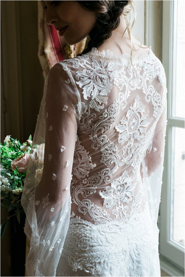 intricate lace sheer back wedding dress