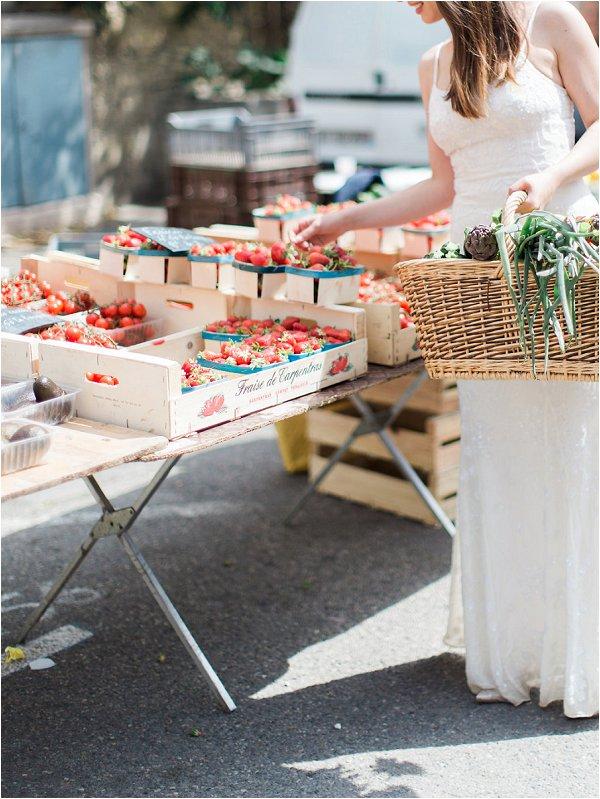 Bride choosing market fresh strawberries to serve at her wedding