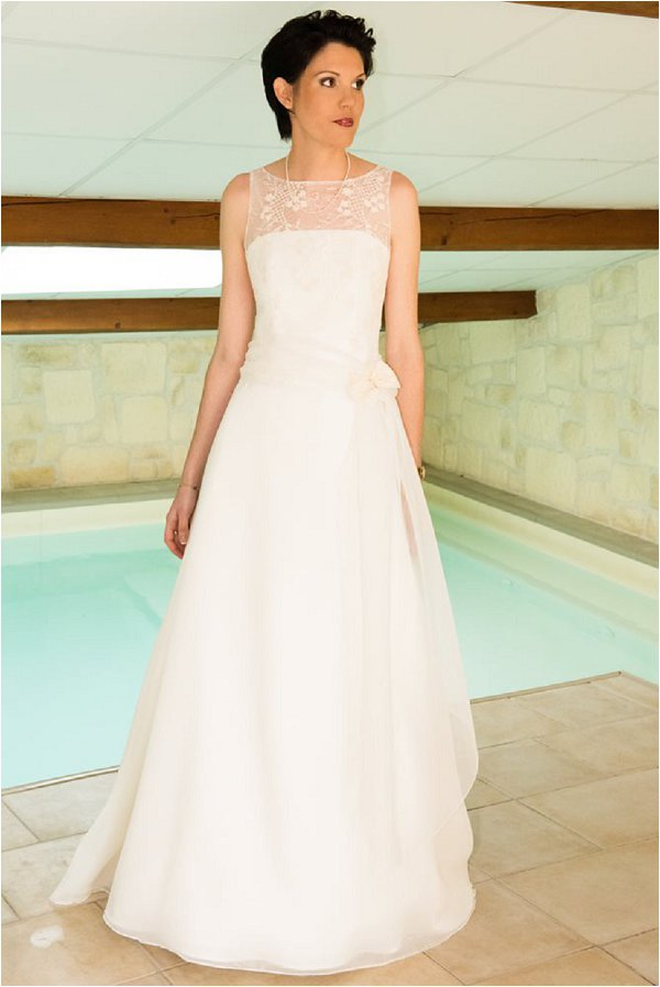 Bride in her gown by the pool at Chateau De Montrouge