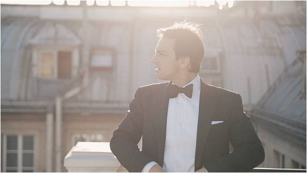 Handsome Groom in his tux on a Paris rooftop