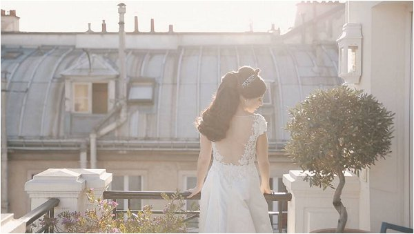 Low back bridal gown with flower details