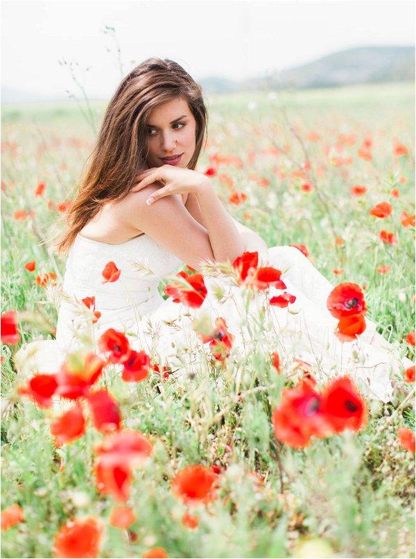 Stunning bride amongst a wild poppy field in provence