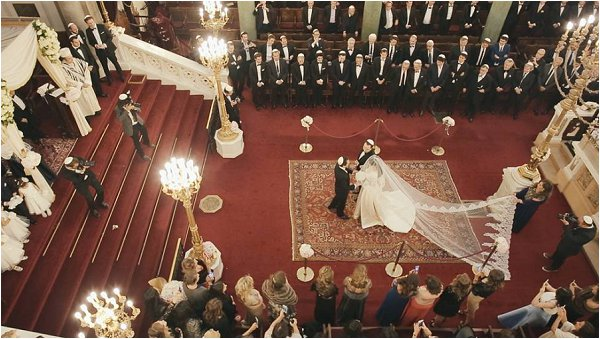Stunning overhead shot of the Brides arrival featuring long veil