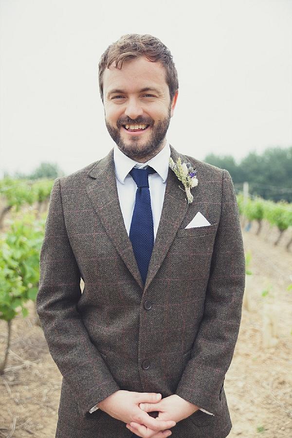 Tweed jacket and knitted tie groom