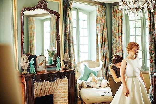bateau neckline sleeveless wedding gown