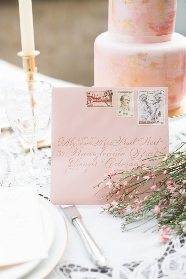 peach wedding cake and stationery