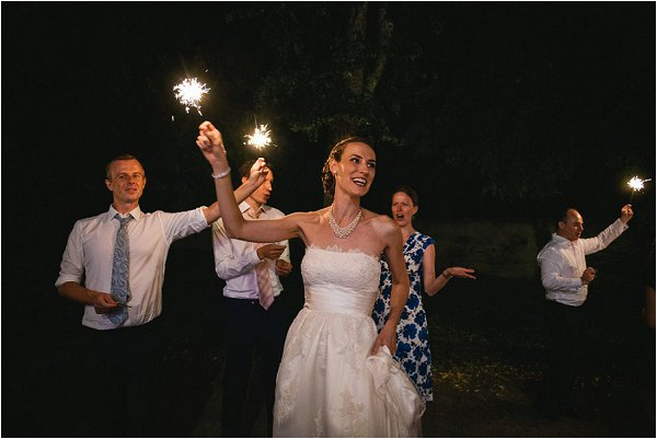 Beautiful bride waves her sparkler