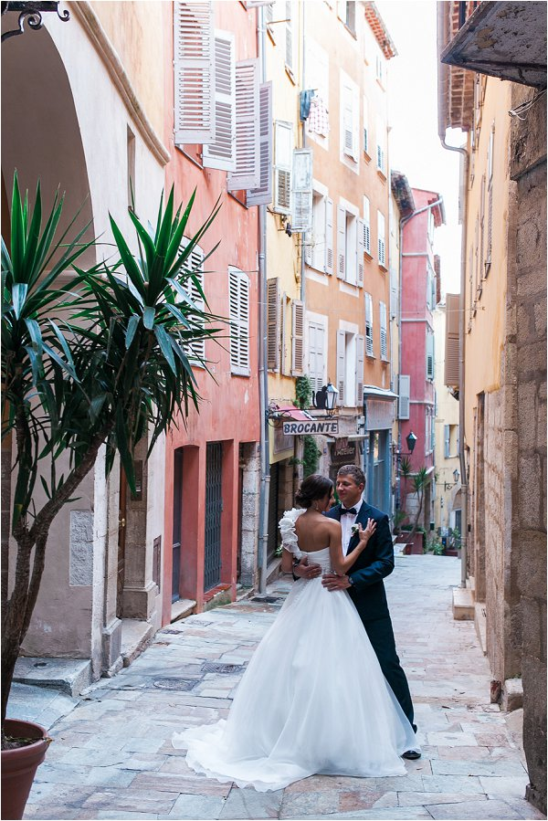 Bride and Groom pose for photos on quiet lane in Grasse