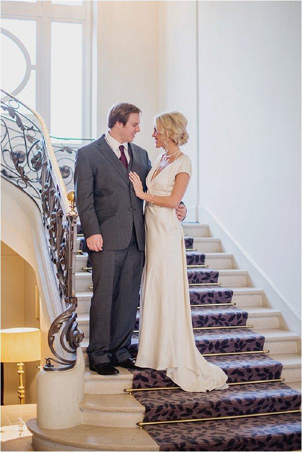 Bride and Groom posing on the ornate stairs