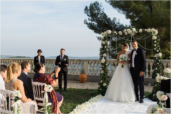 Bride and groom facing their guests after Grasse ceremony