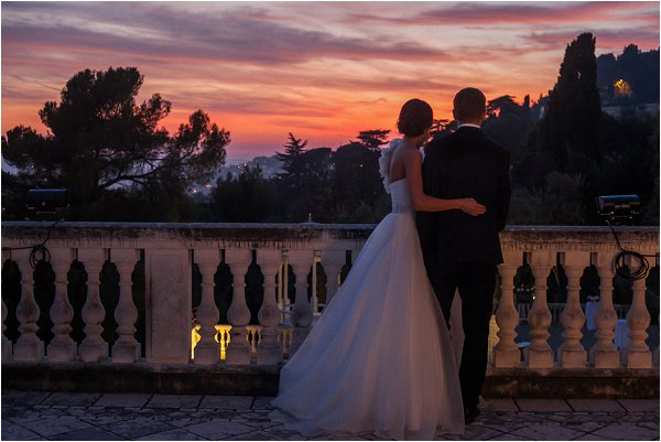Bride and groom overlooking Grasse at sunset
