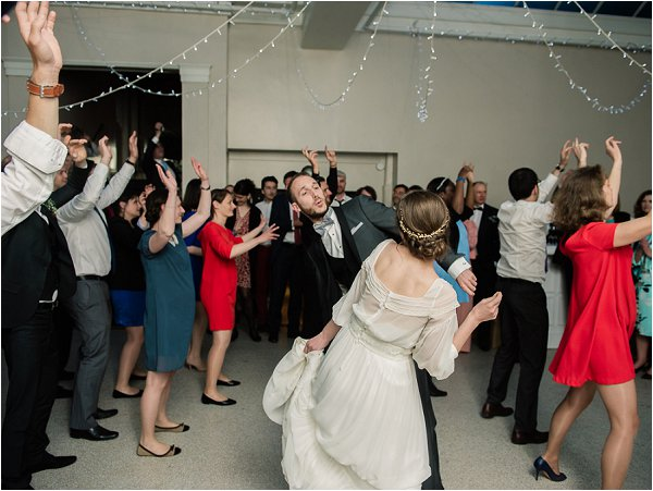 Bride groom and their guests perform the first dance
