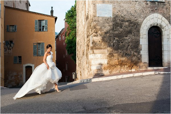 Bride wearing her princess gown outside medieval buildings