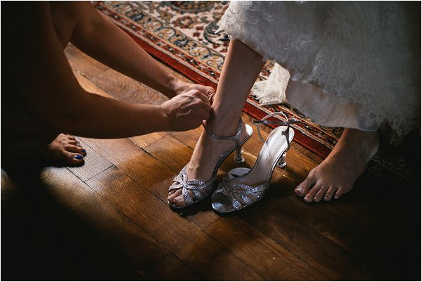 Bridemaid fastens brides sparkling heels