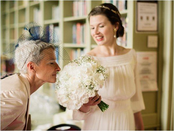 Brides mum enjoys the white bridal bouquet