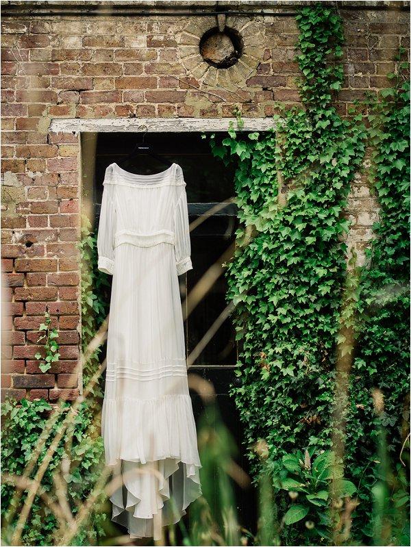Delphine Manivet wedding dress hangs ready for the bride