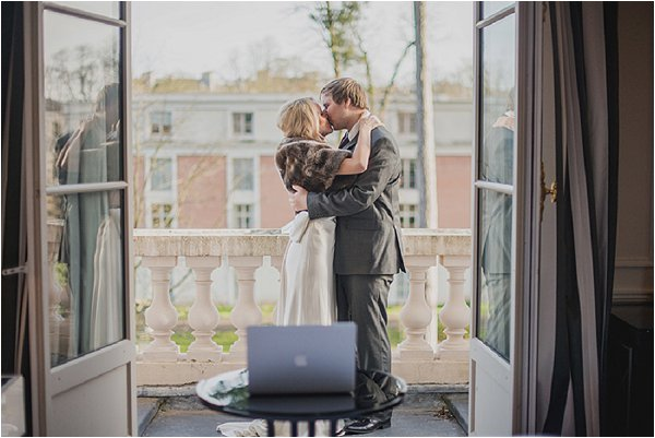 First married kiss on the balcony at Hotel Trianon
