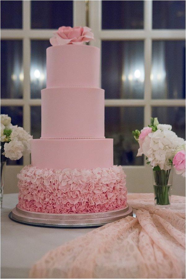 Four tiered pastel pink wedding cake