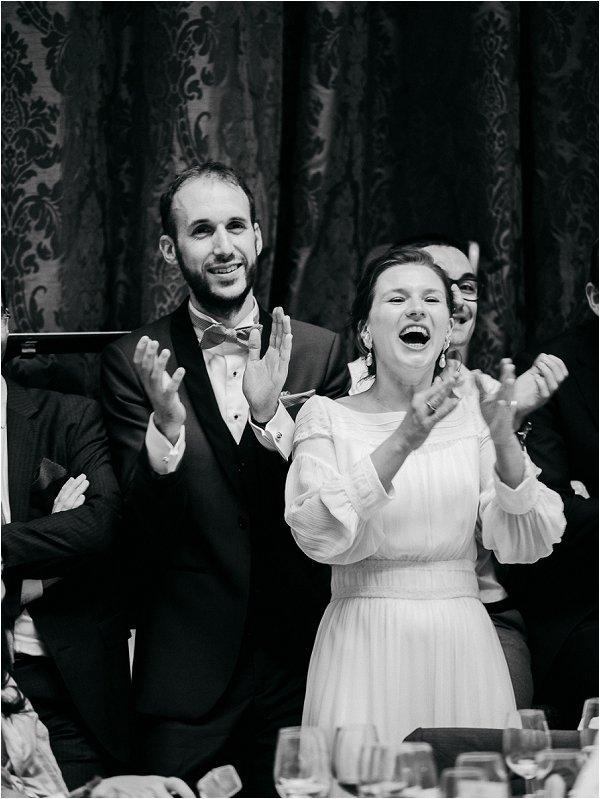 Happy newlyweds applaud performance