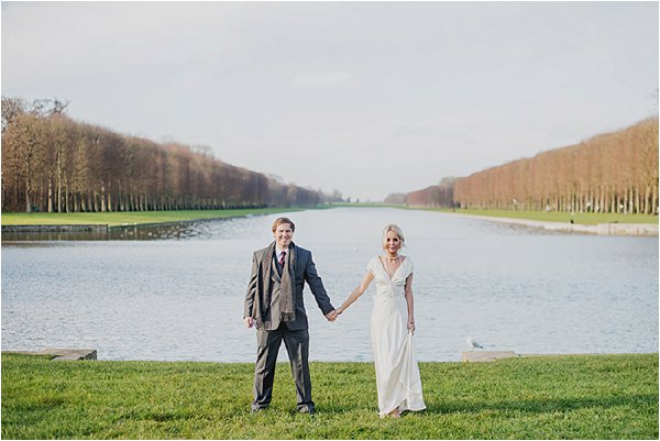 Holding hands by the lake at Versailles