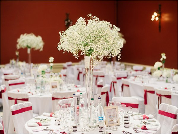 Red and white wedding reception at Hampton Court House