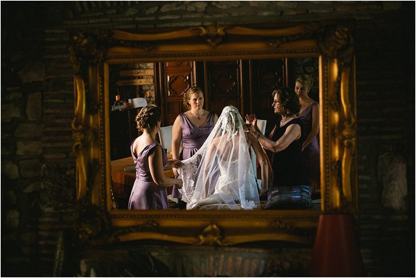 Reflections of the bridal party making last minute preparations