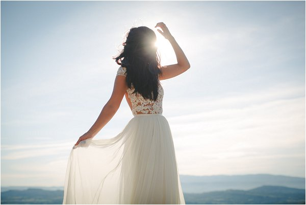 Bride wearing hand made gown in the sunlight