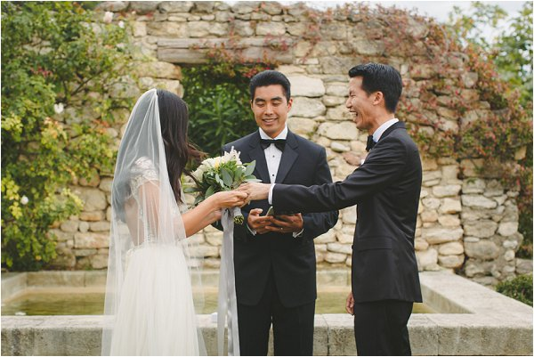 Exchanging rings in outdoor wedding ceremony in Provence