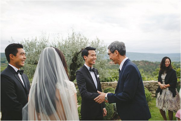 Father of the Groom shakes his Son in Laws hand