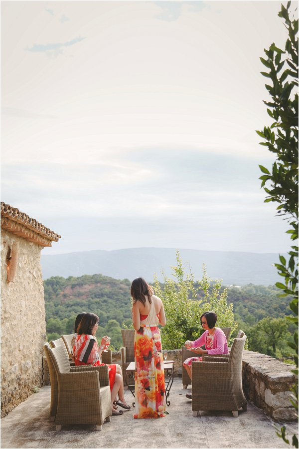 Female wedding guests relaxing with a stunning view