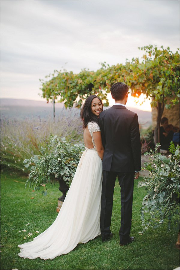From behind with stunning backless hand made gown