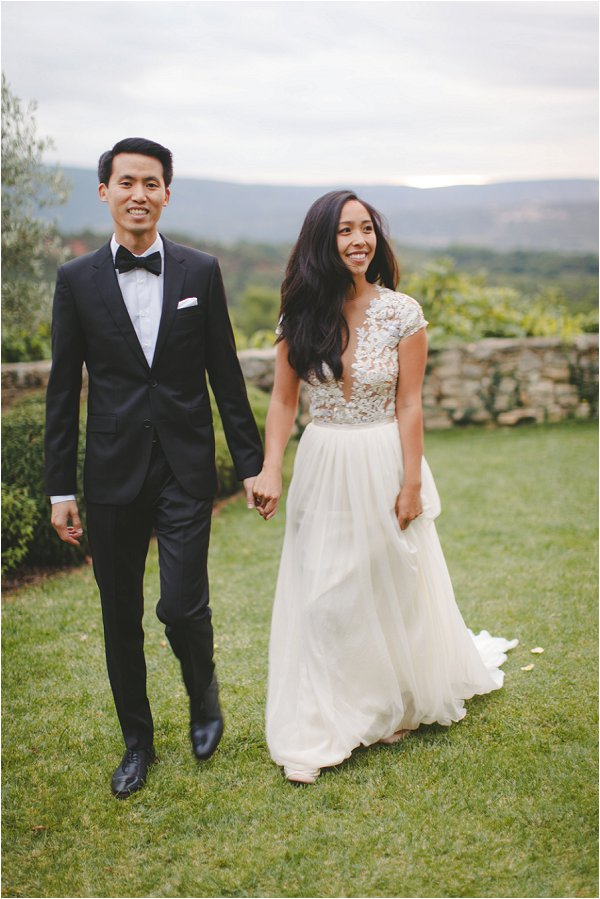 Groom wears tux and Bride wears stunning hand made gown