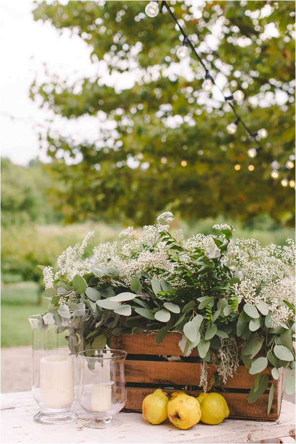 Simple wedding flowers displayed in wooden crates